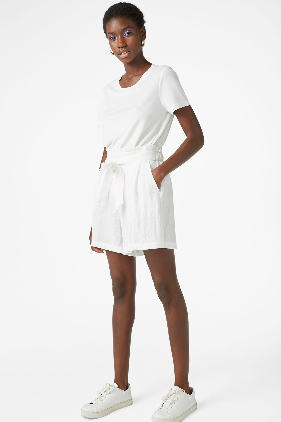 Model front image of Monki flowy shorts in white