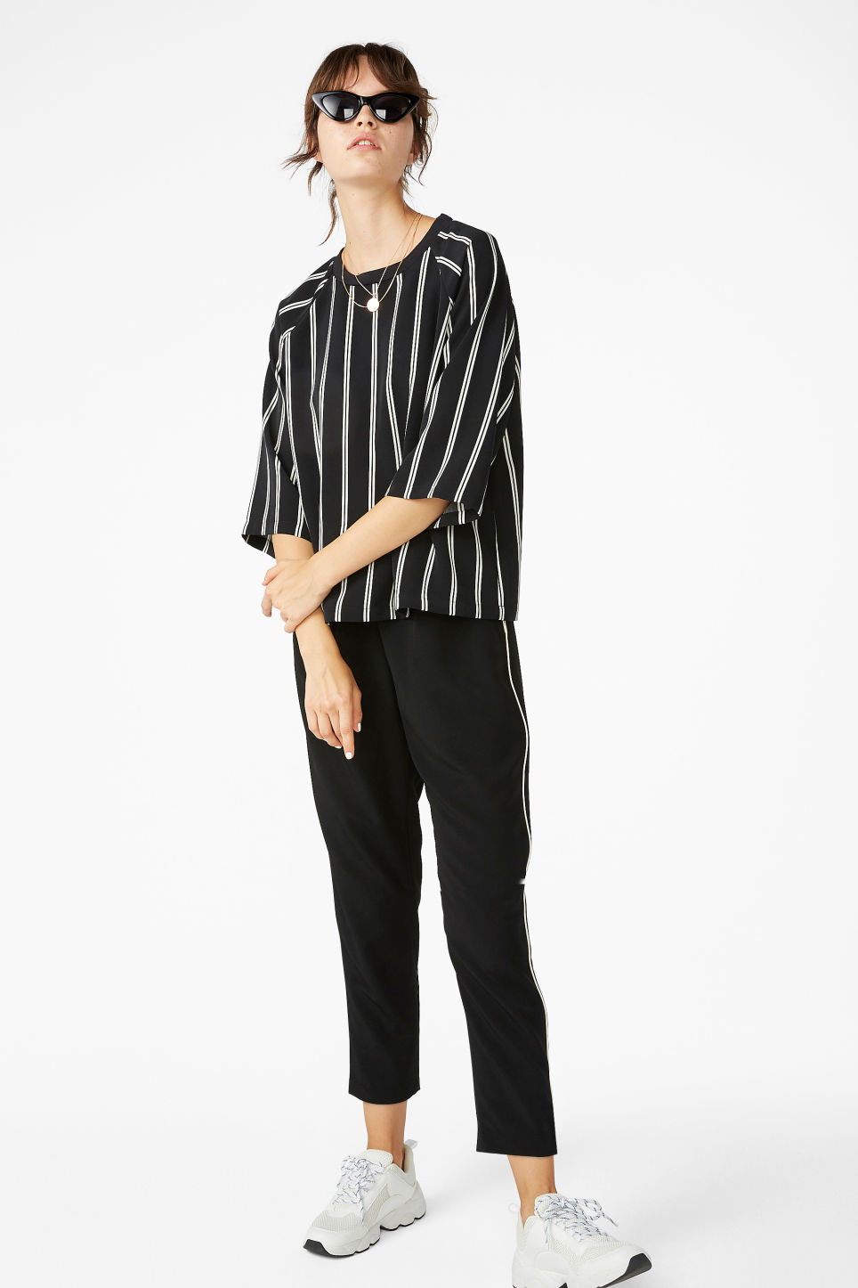 Model front image of Monki sport luxe top in black