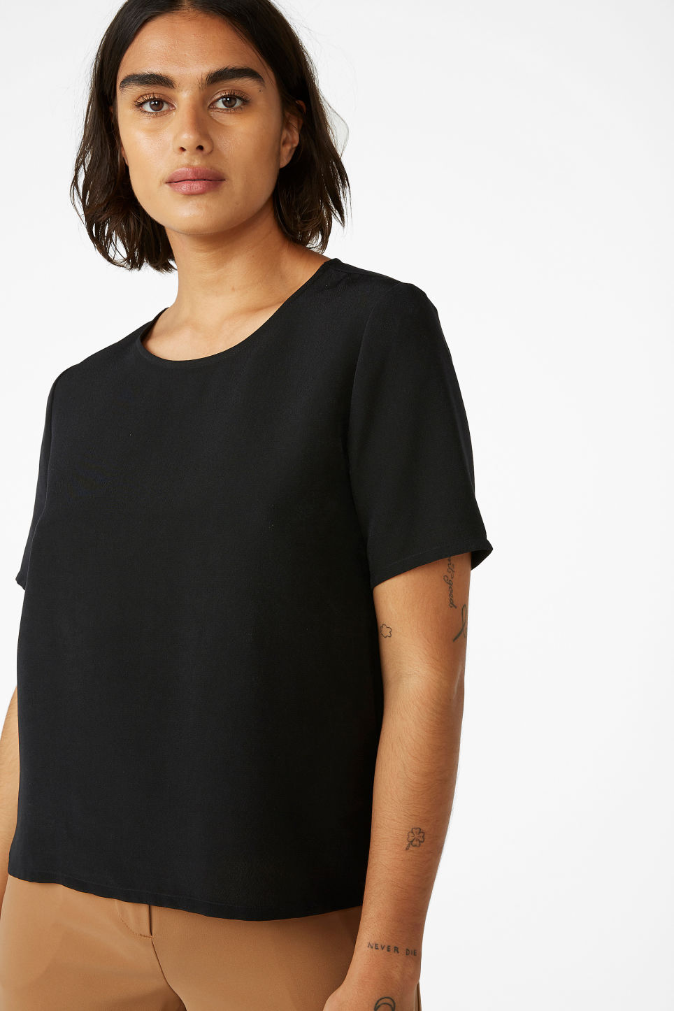 Model front image of Monki short-sleeved blouse in black