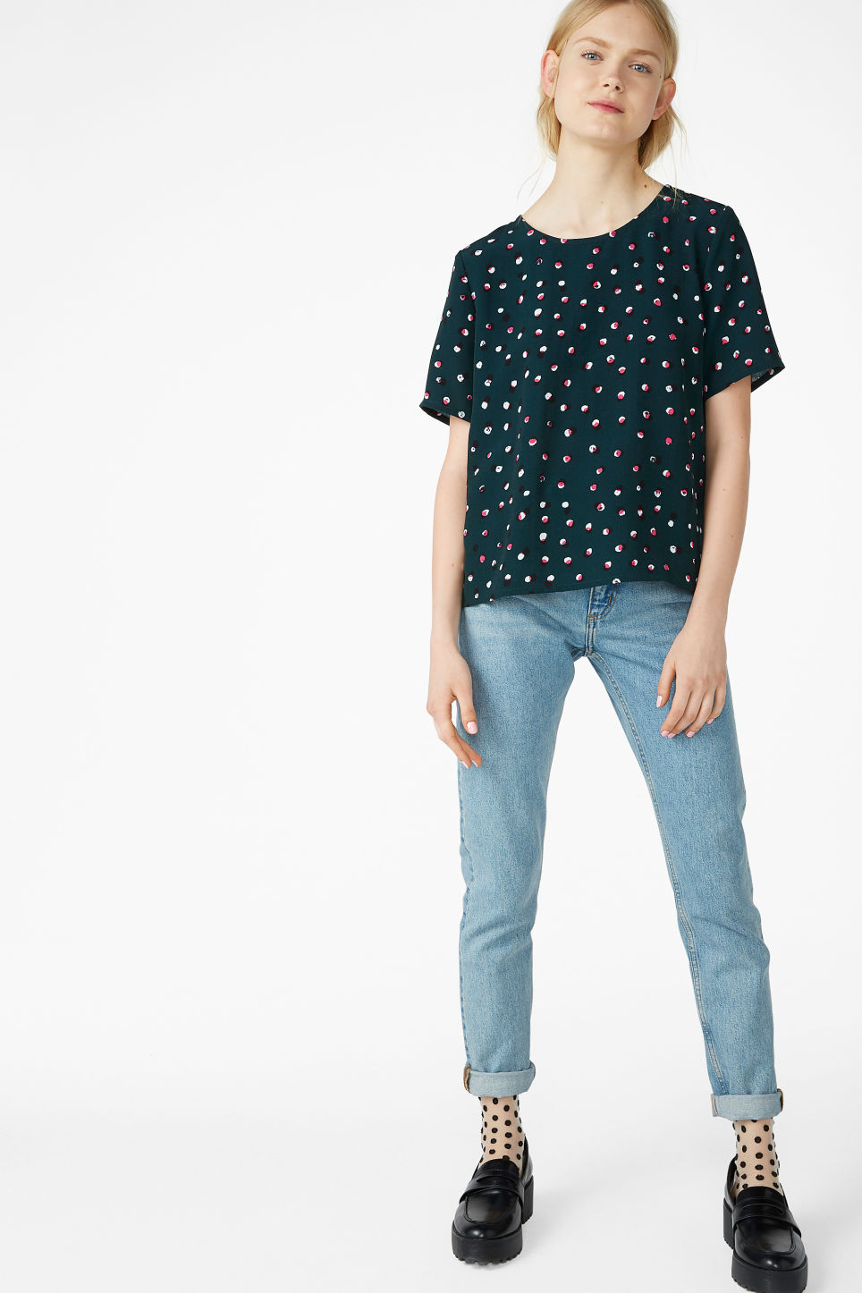 Model side image of Monki short-sleeved blouse in green