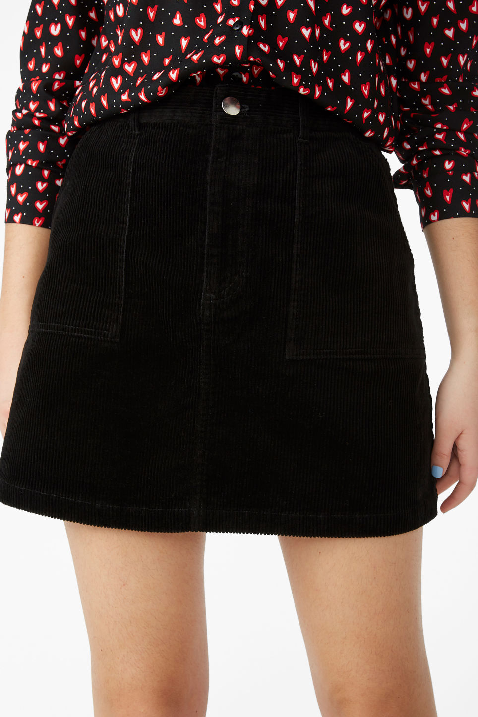Model side image of Monki a-line cord mini skirt in black