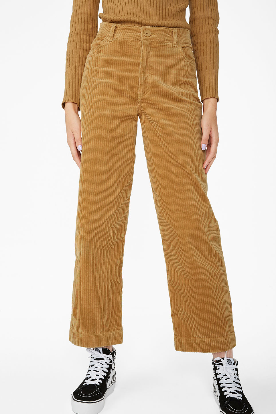 Model side image of Monki wide leg corduroy trousers in yellow