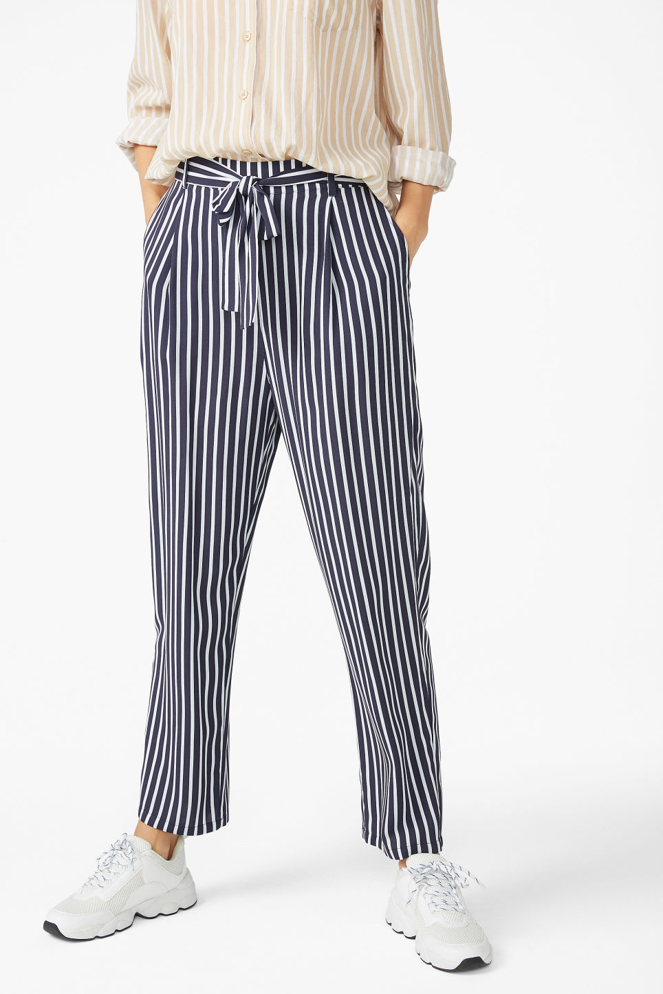 Model side image of Monki flowy striped trousers in blue