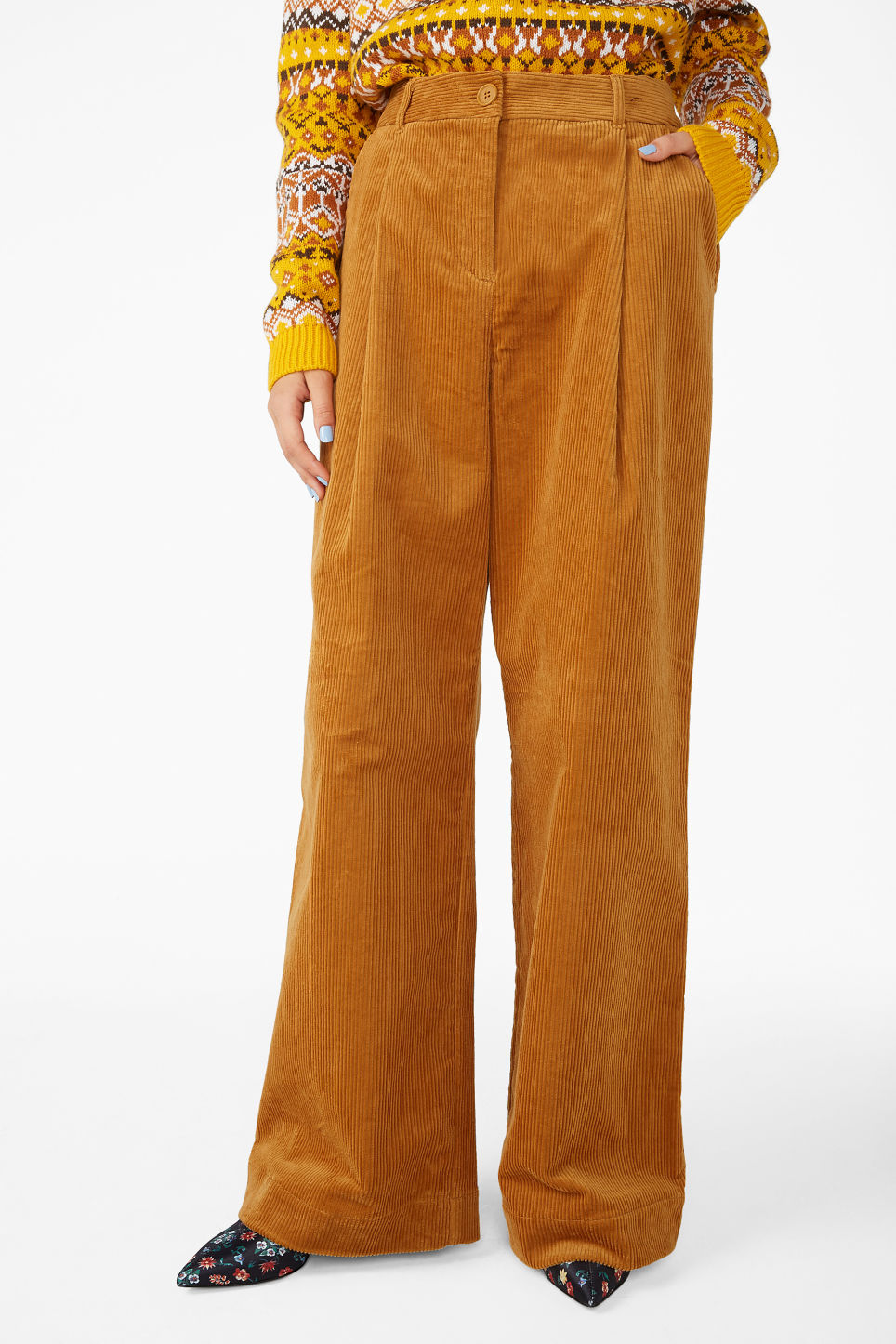 Model side image of Monki corduroy trousers in yellow