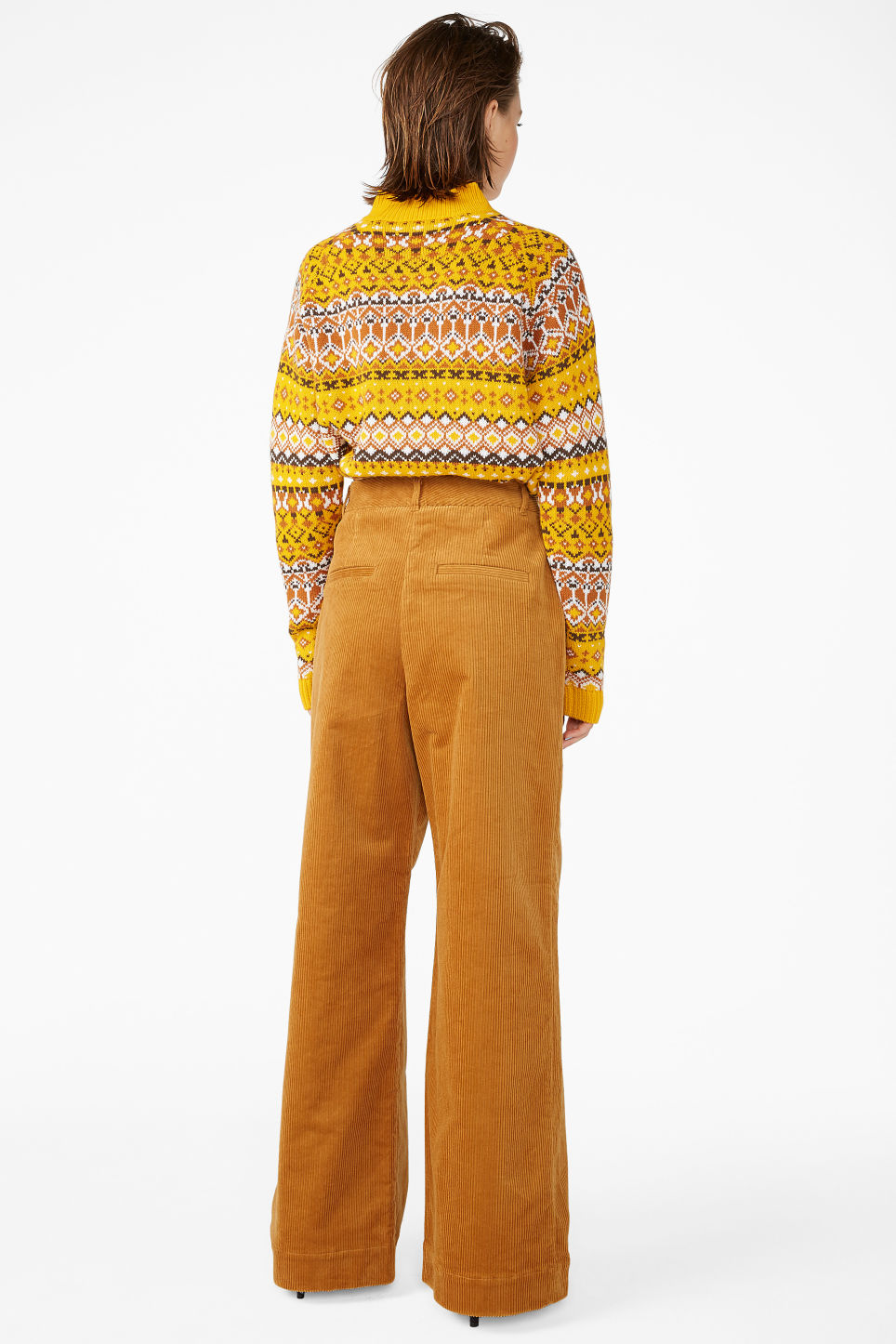 Model back image of Monki corduroy trousers in yellow