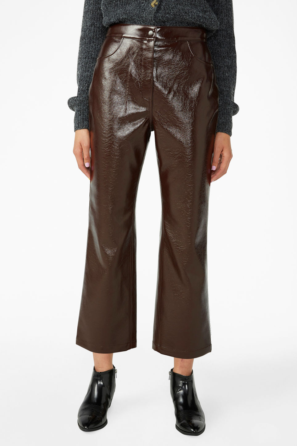 Model side image of Monki faux patent leather trousers in brown