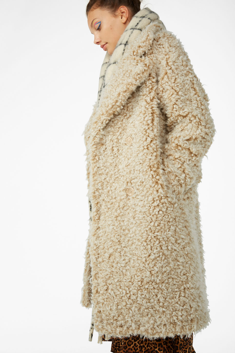 Model front image of Monki faux shearling coat in beige