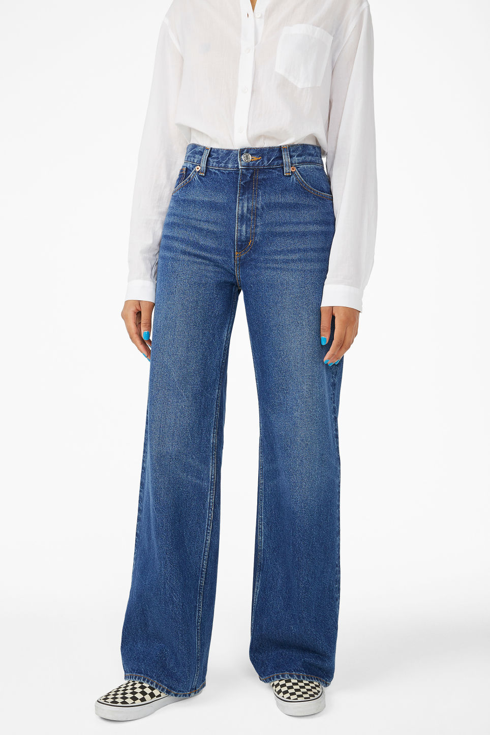 Model side image of Monki yoko mid blue jeans in blue