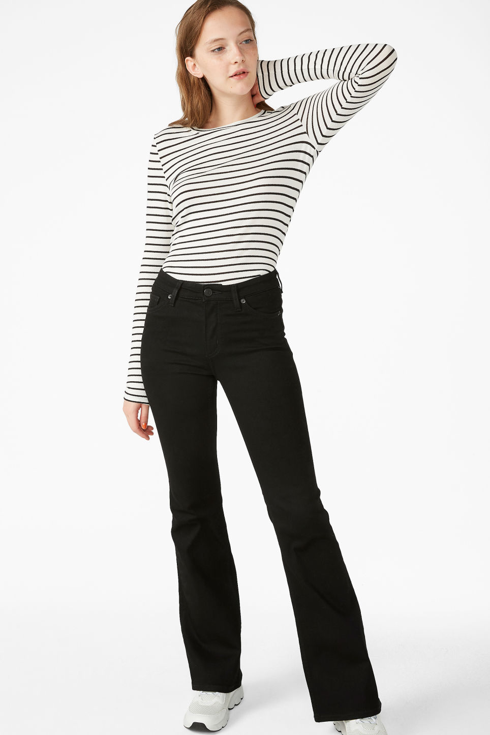 Model side image of Monki fitted long-sleeved top in white