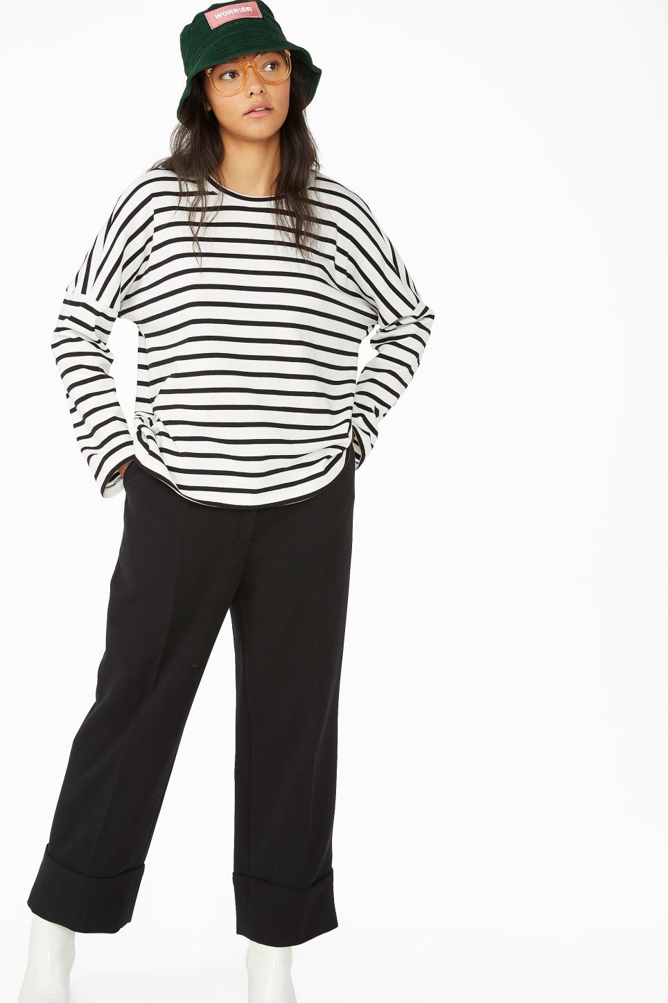 Model side image of Monki oversized sweater in black
