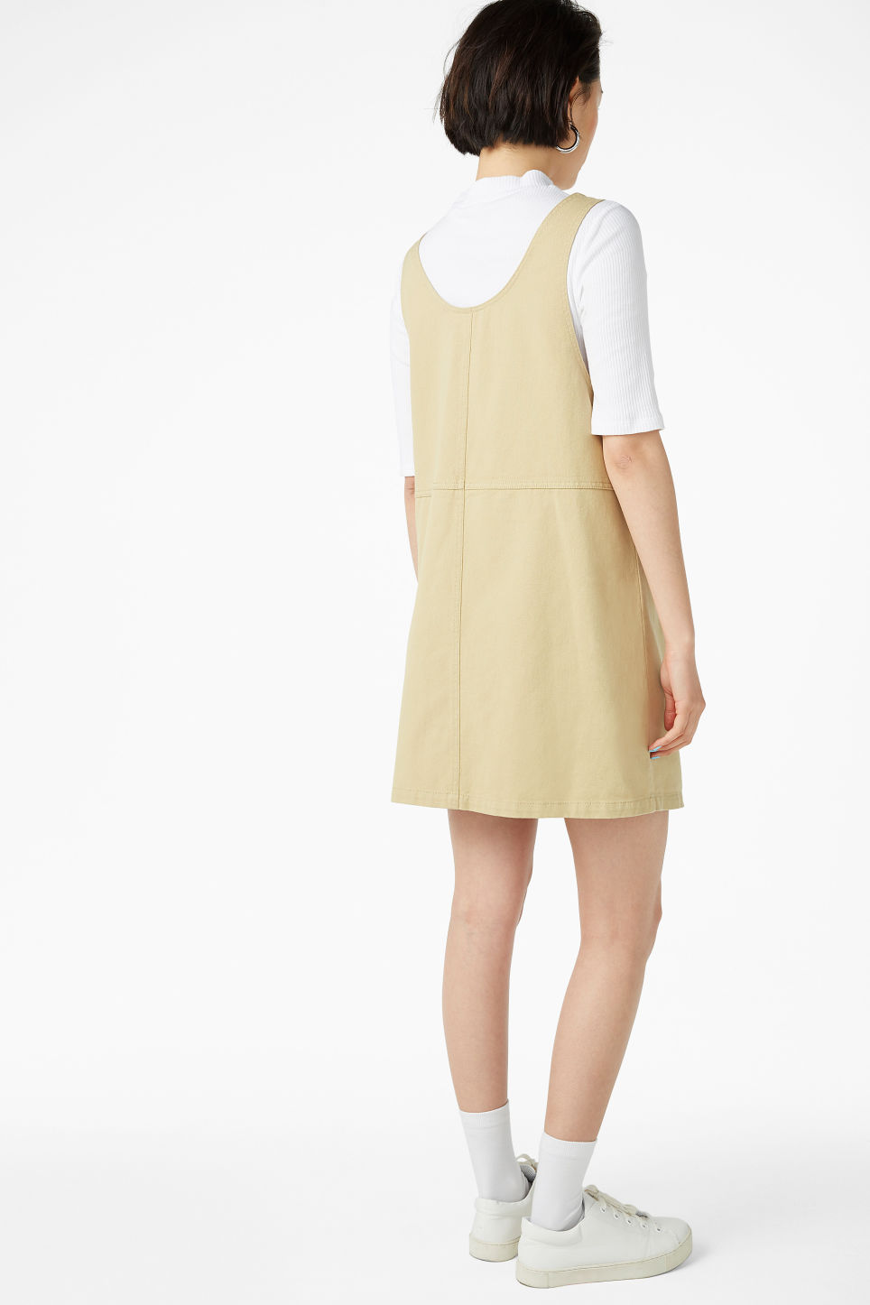 Model back image of Monki denim pinafore dress  in beige