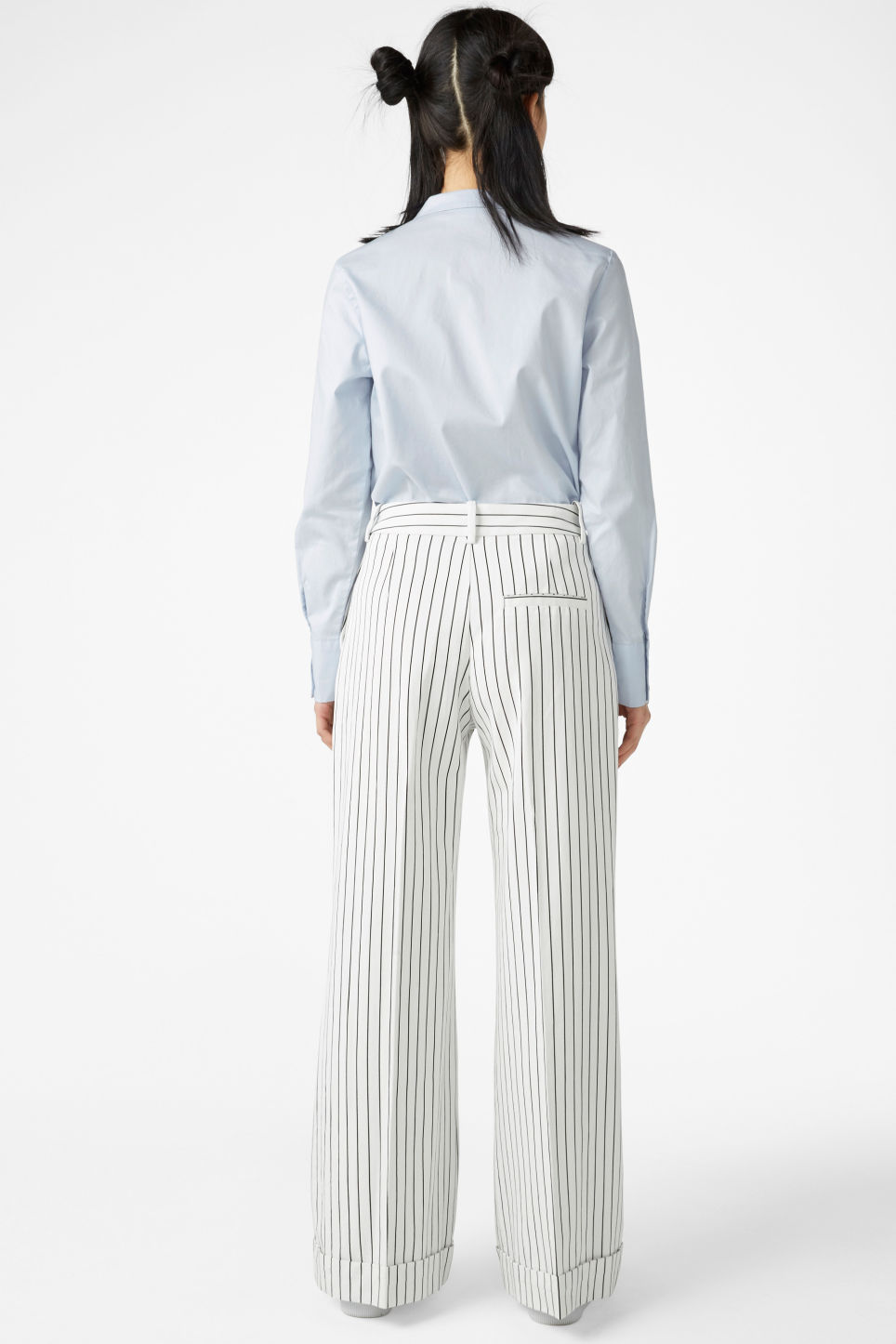 Model back image of Monki wide leg trousers in white
