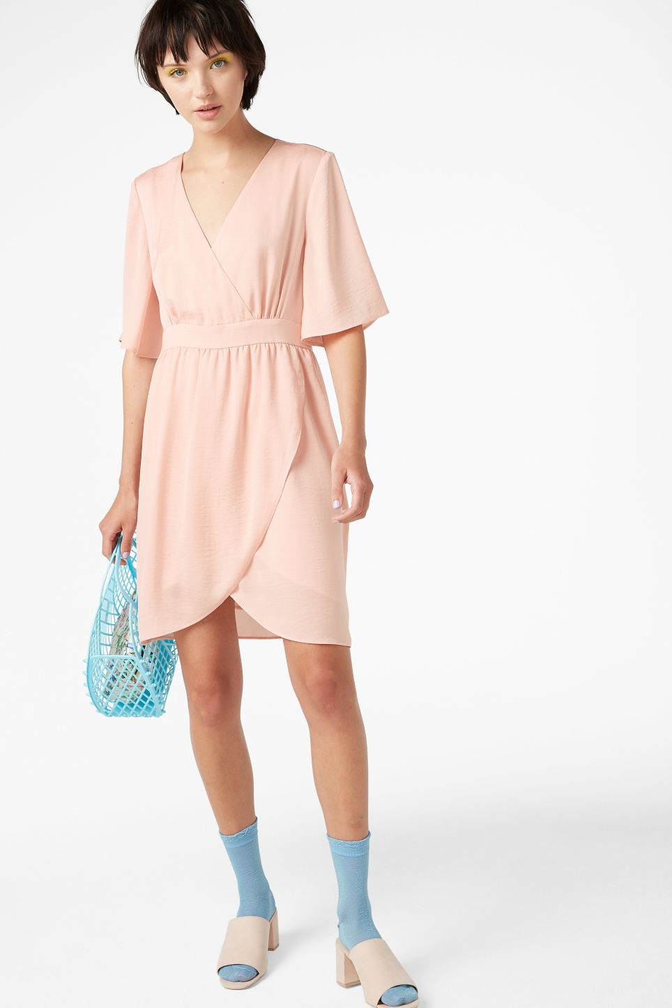 Model side image of Monki silky dress in orange