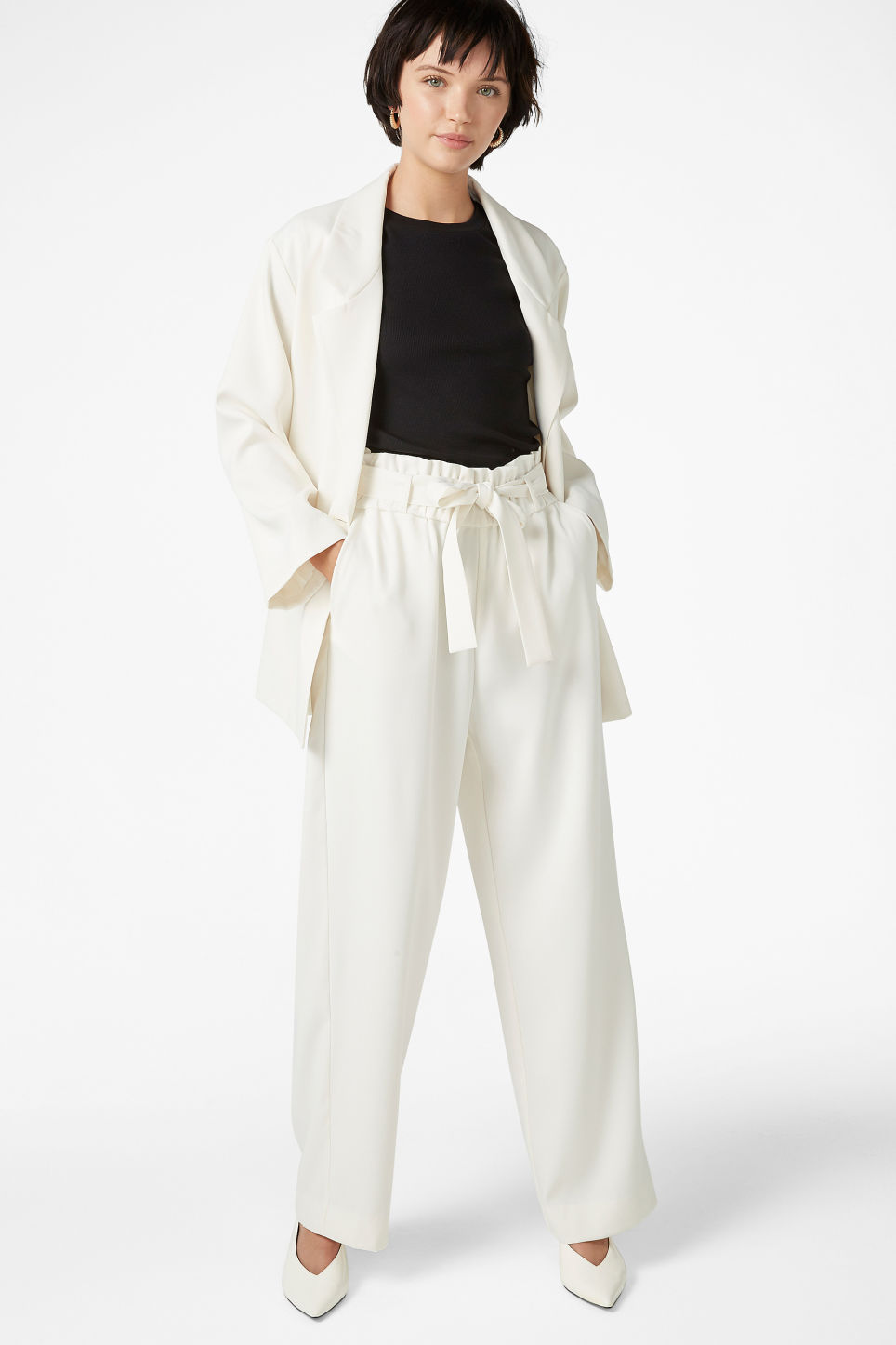 Model front image of Monki flowy trousers in white