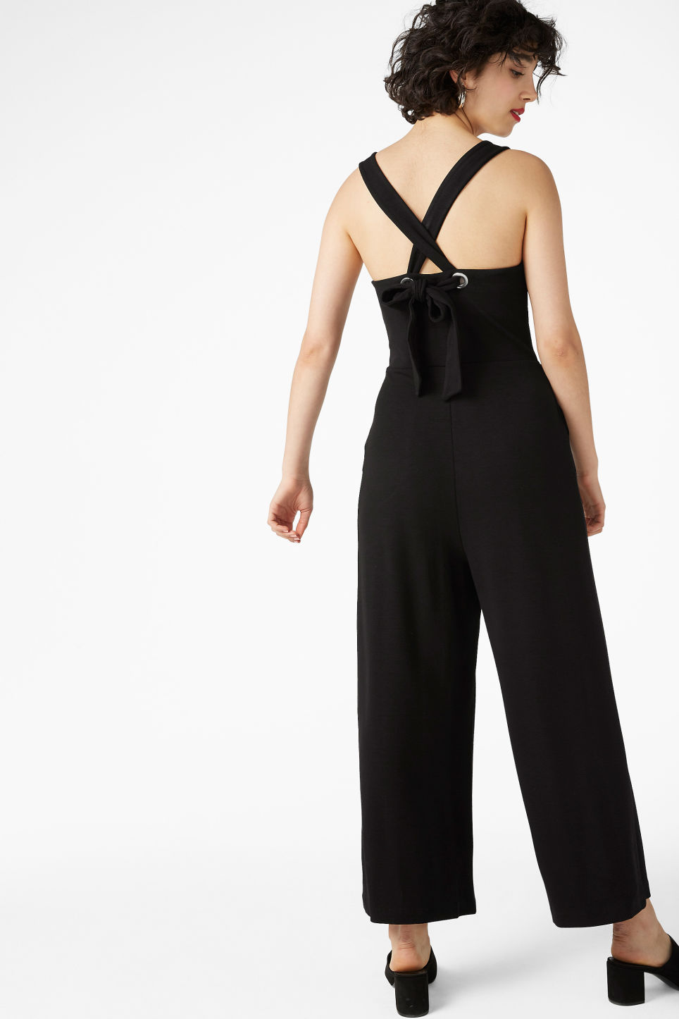 Model back image of Monki cross back jumpsuit in black