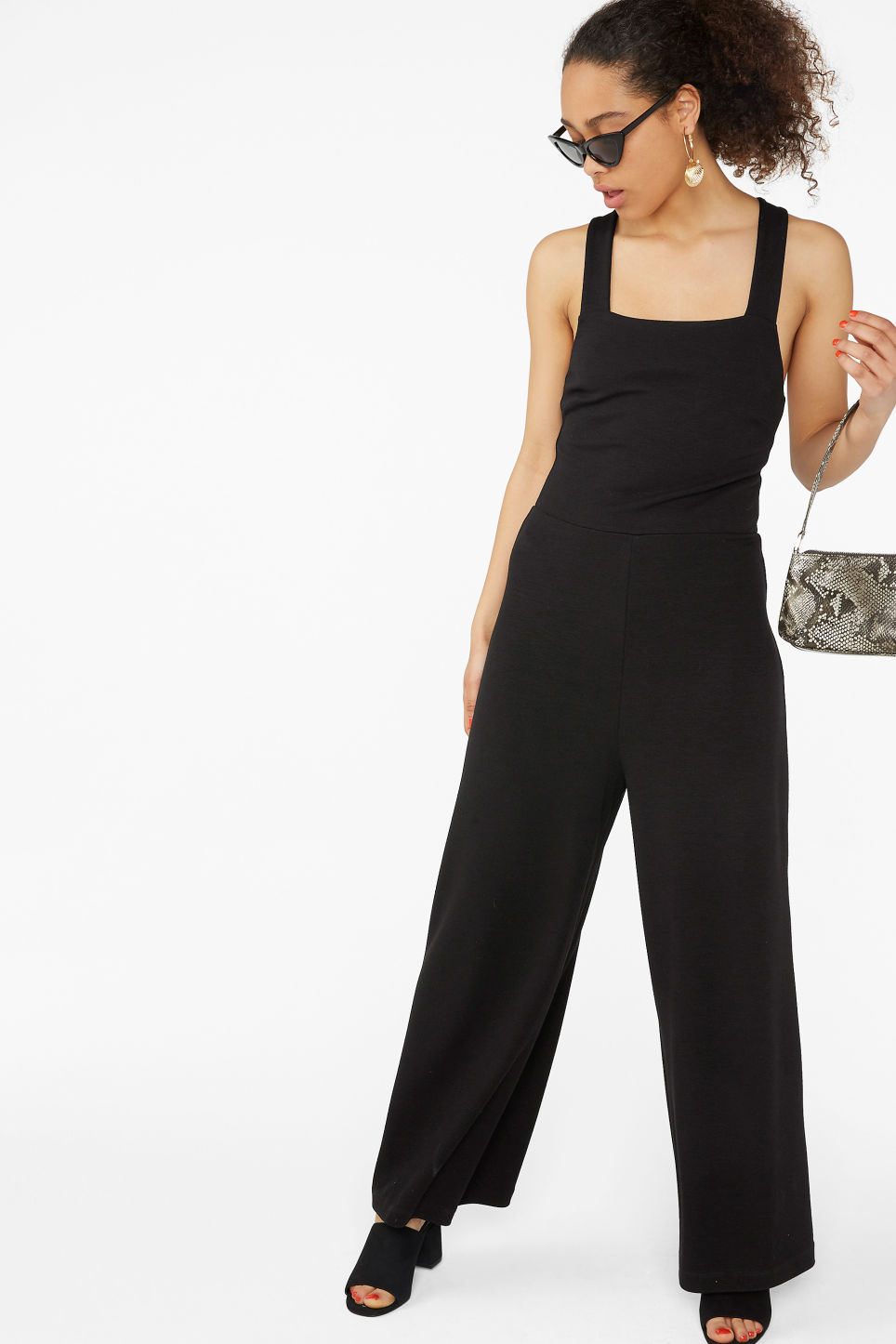Model front image of Monki cross back jumpsuit in black