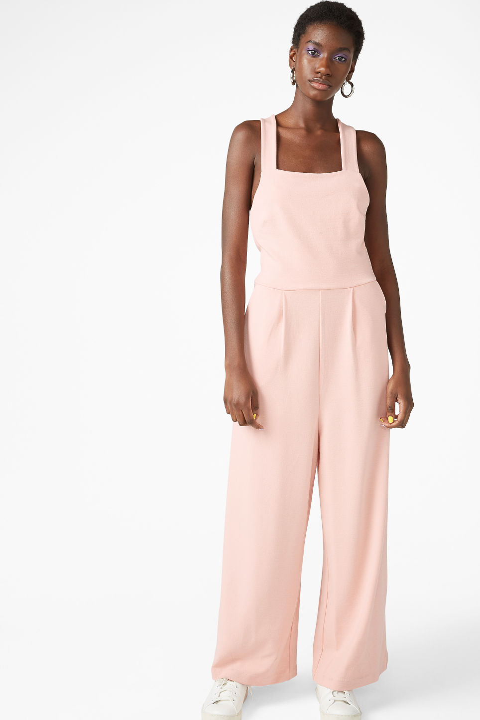 Model front image of Monki cross back jumpsuit in orange