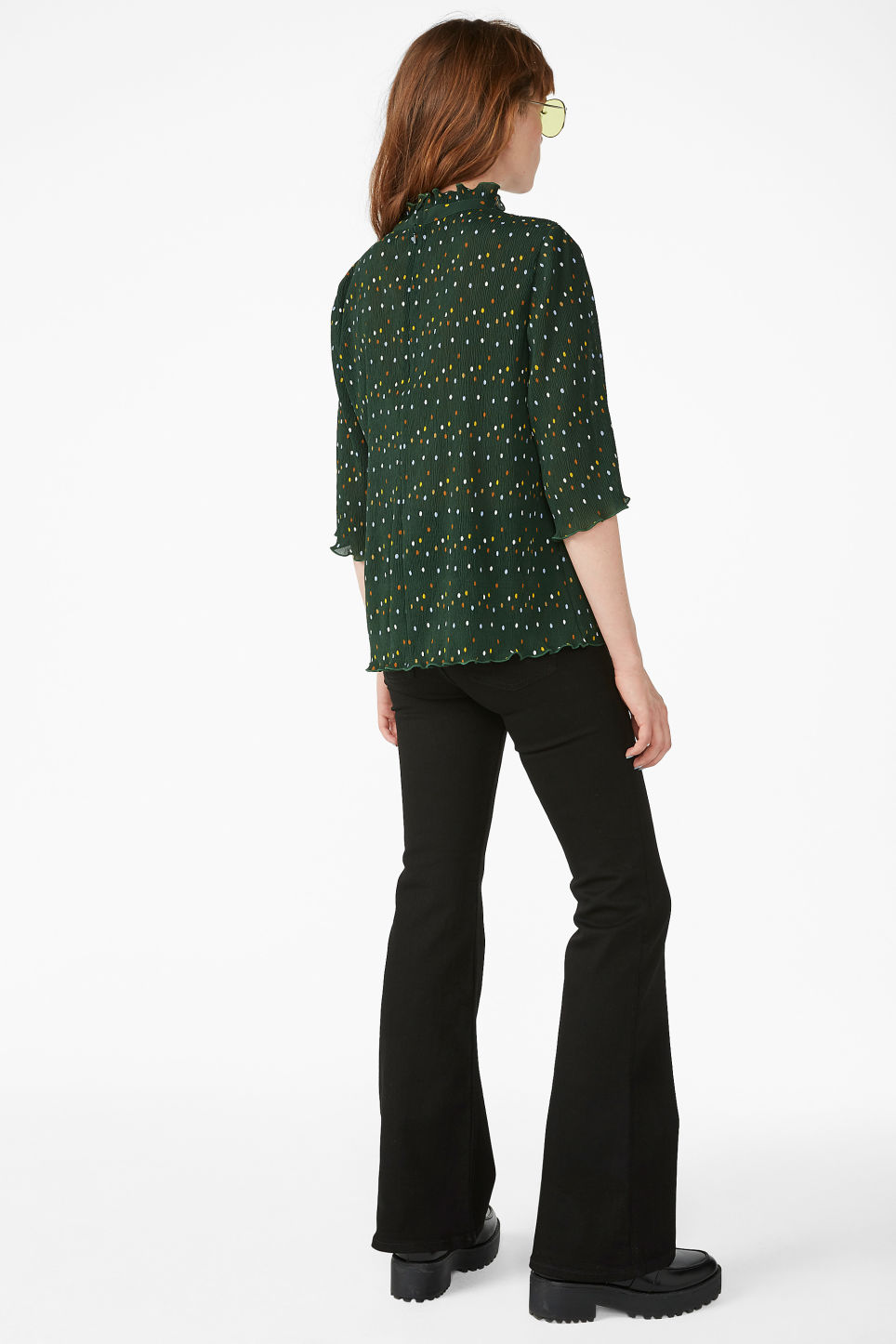 Model back image of Monki shirred ruffle neck blouse in green