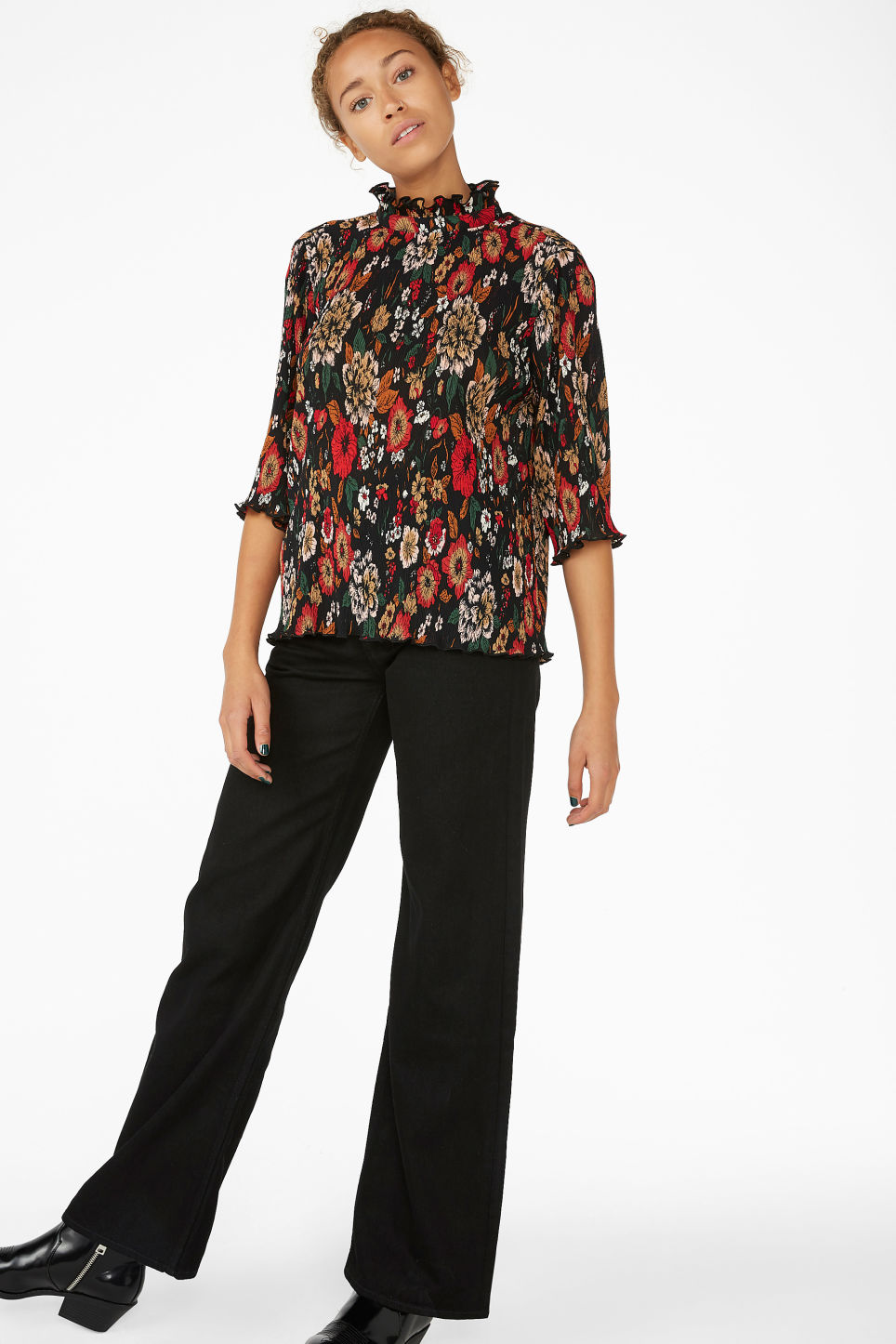 Model front image of Monki shirred ruffle neck blouse in black