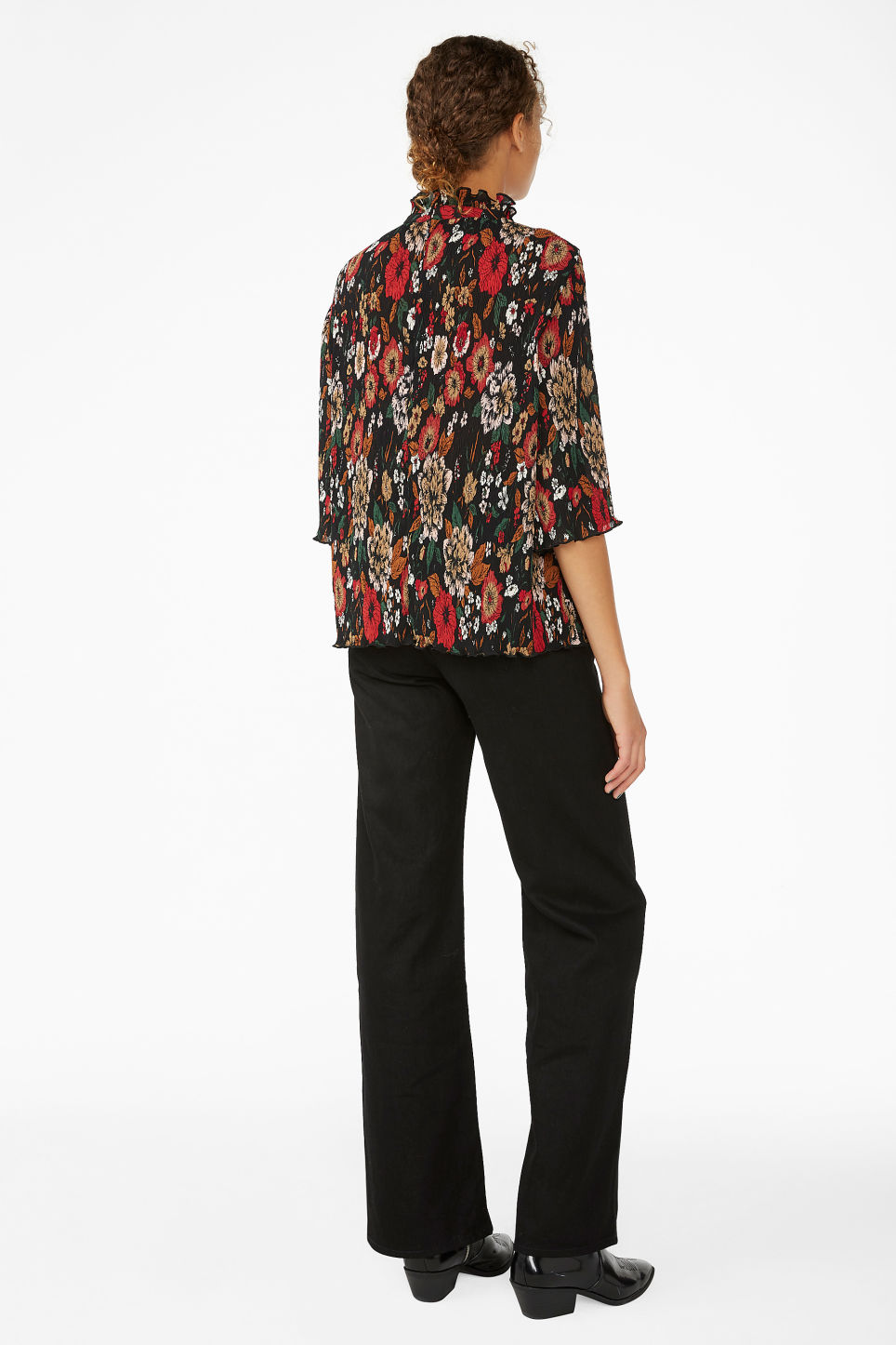 Model back image of Monki shirred ruffle neck blouse in black