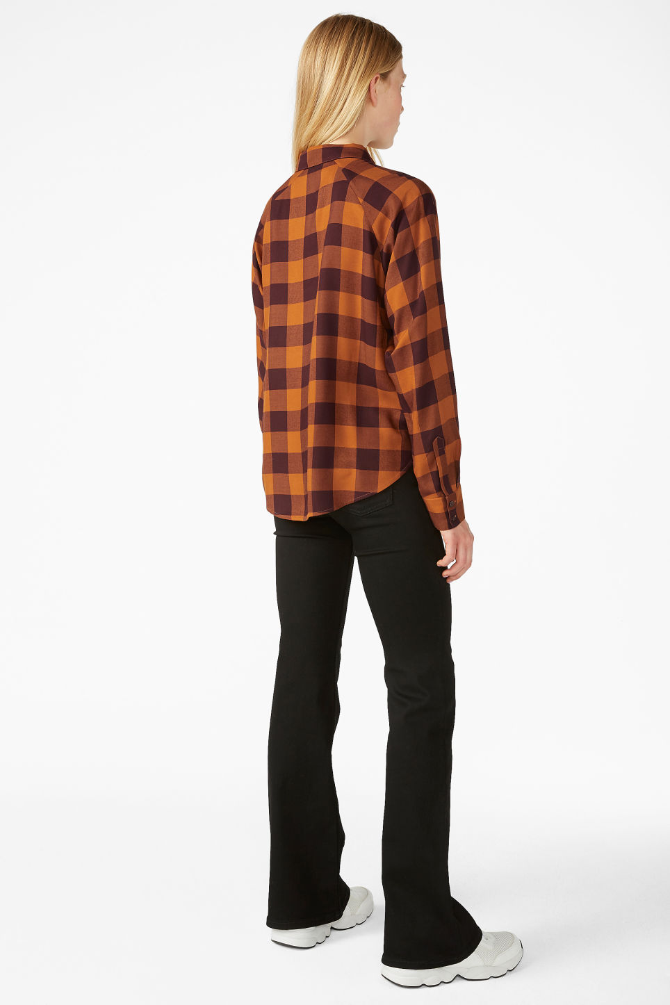 Model back image of Monki button-up shirt in orange