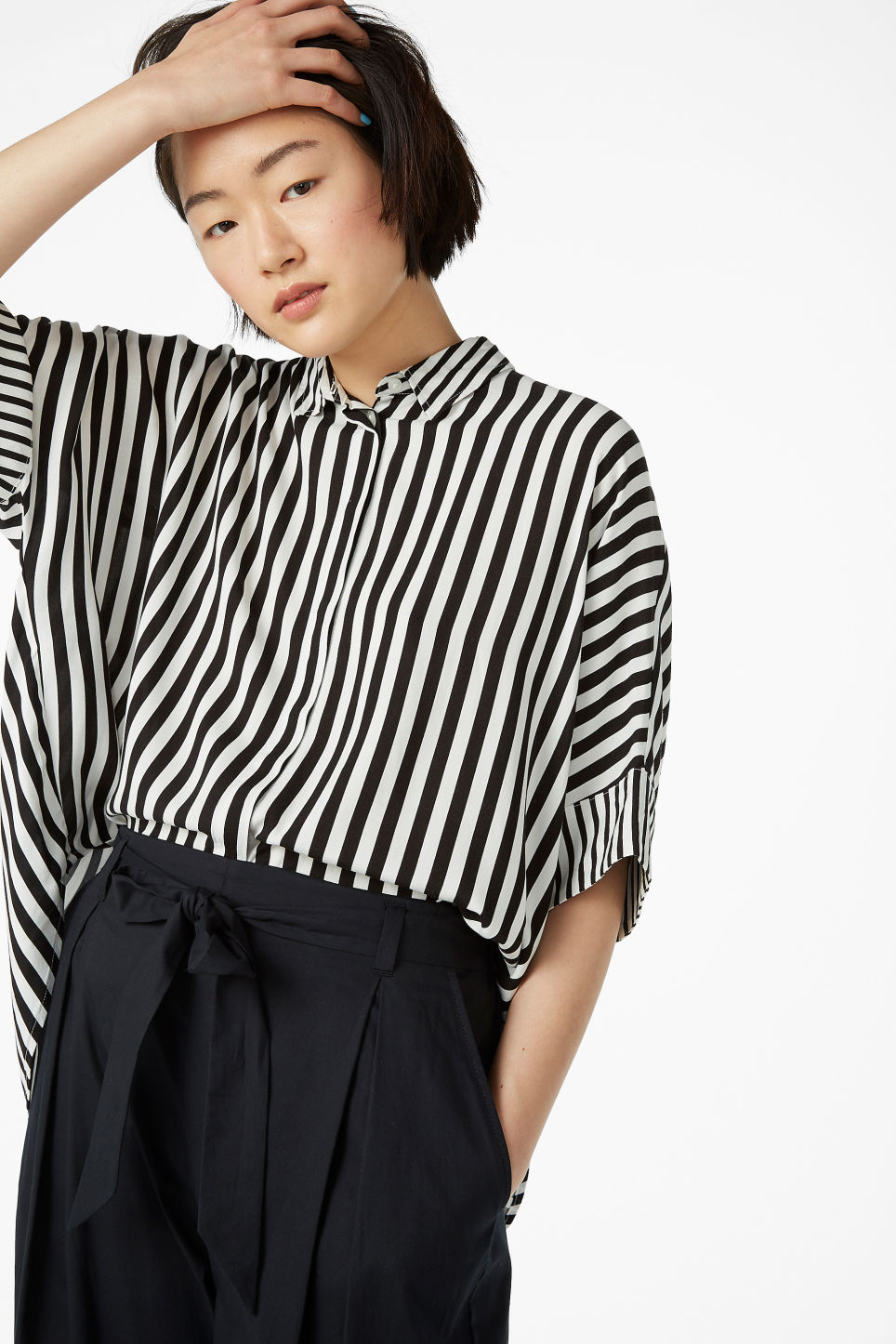 Model front image of Monki oversized boxy shirt in white