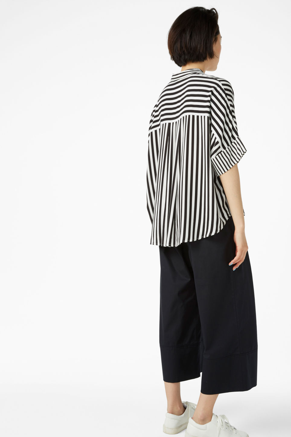 Model back image of Monki oversized boxy shirt in white