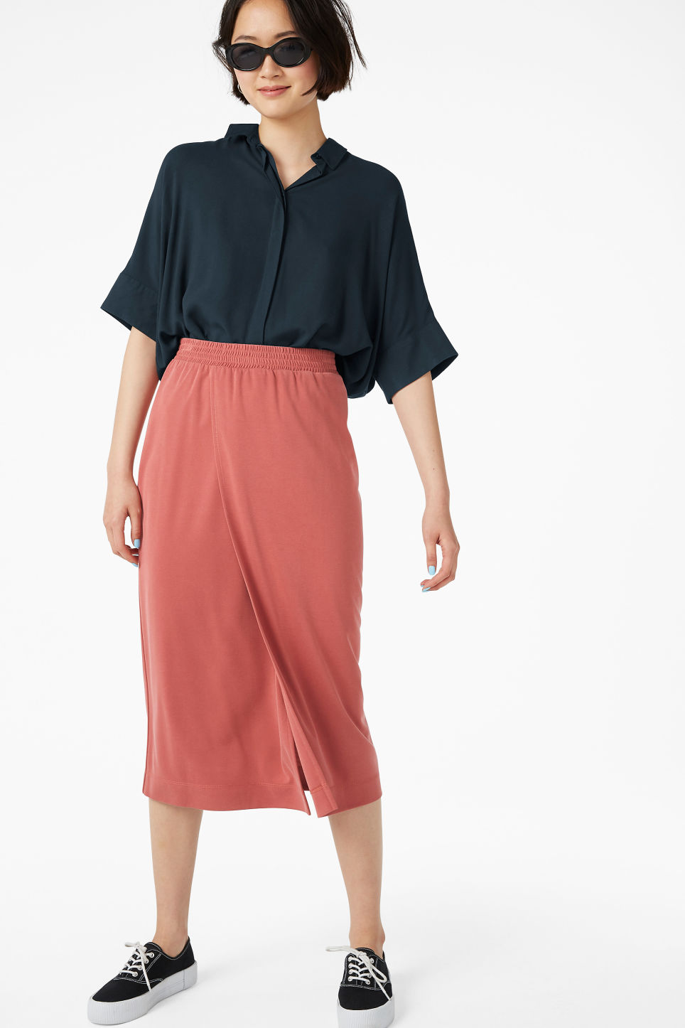Model side image of Monki oversized boxy shirt in blue