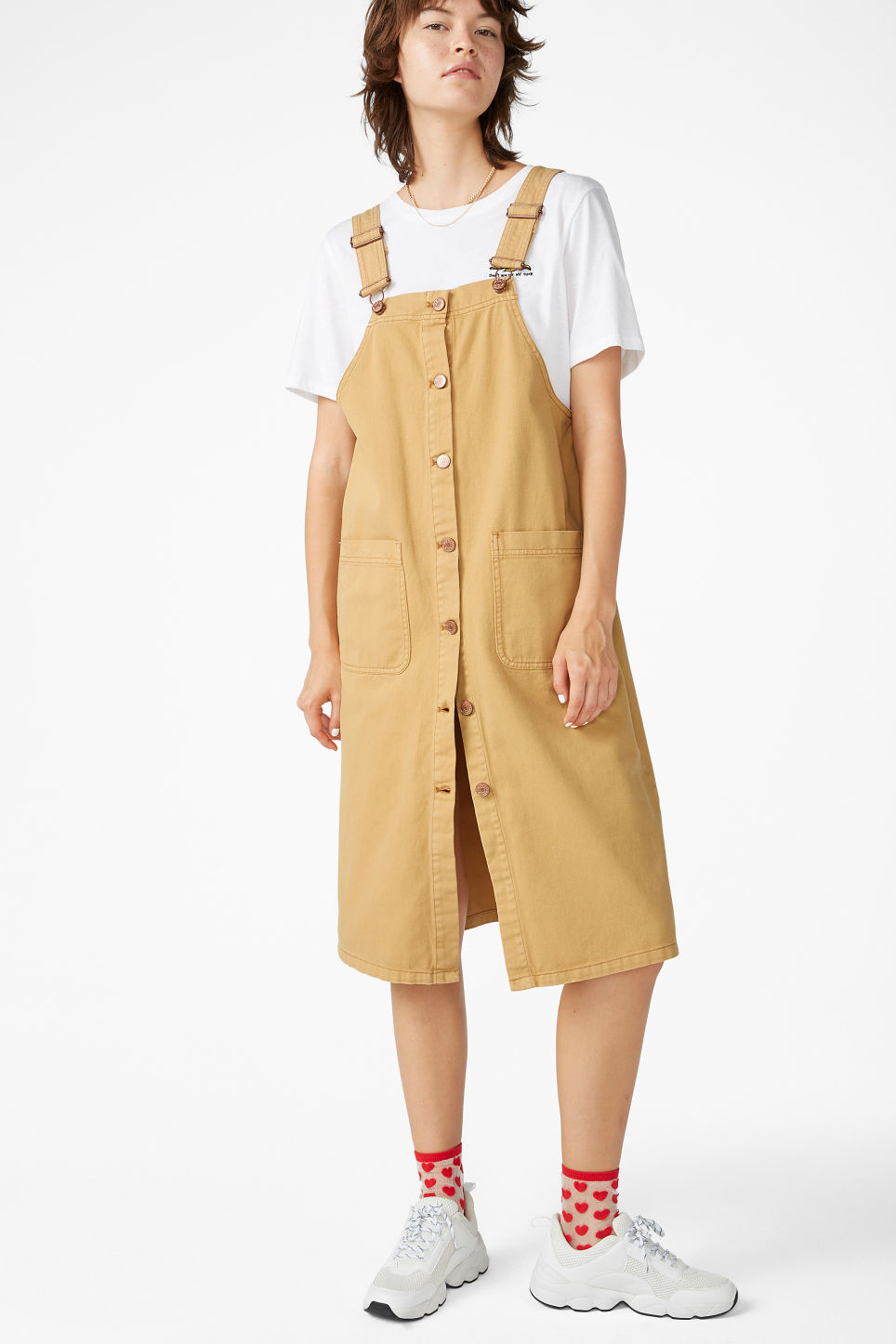 Model front image of Monki buttoned denim dungaree dress in yellow