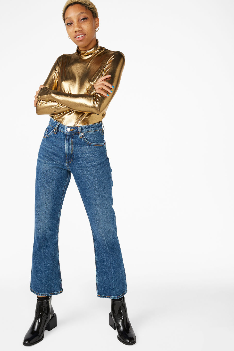 Model front image of Monki shiny turtleneck  in gold