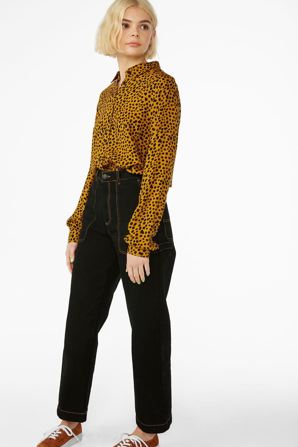 Model side image of Monki classic button-up shirt  in yellow