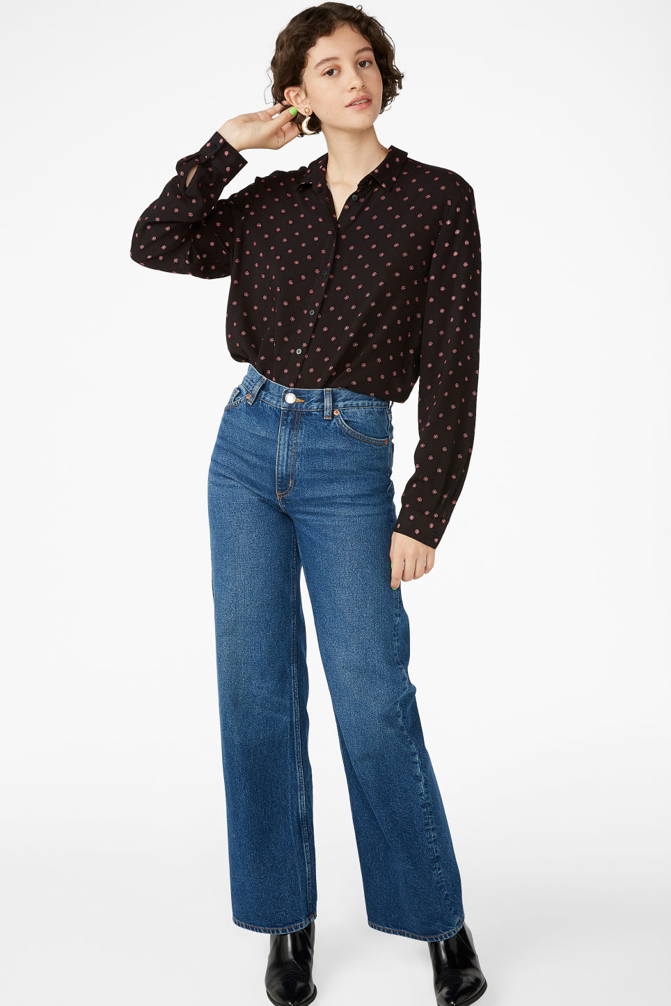 Model side image of Monki classic button-up shirt  in black