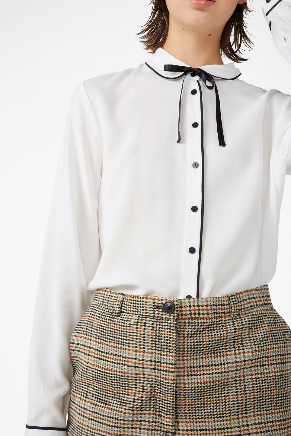 Model side image of Monki classic button-up shirt  in white