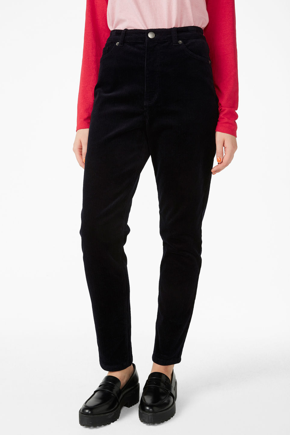 Model side image of Monki slim fit corduroy trousers in blue