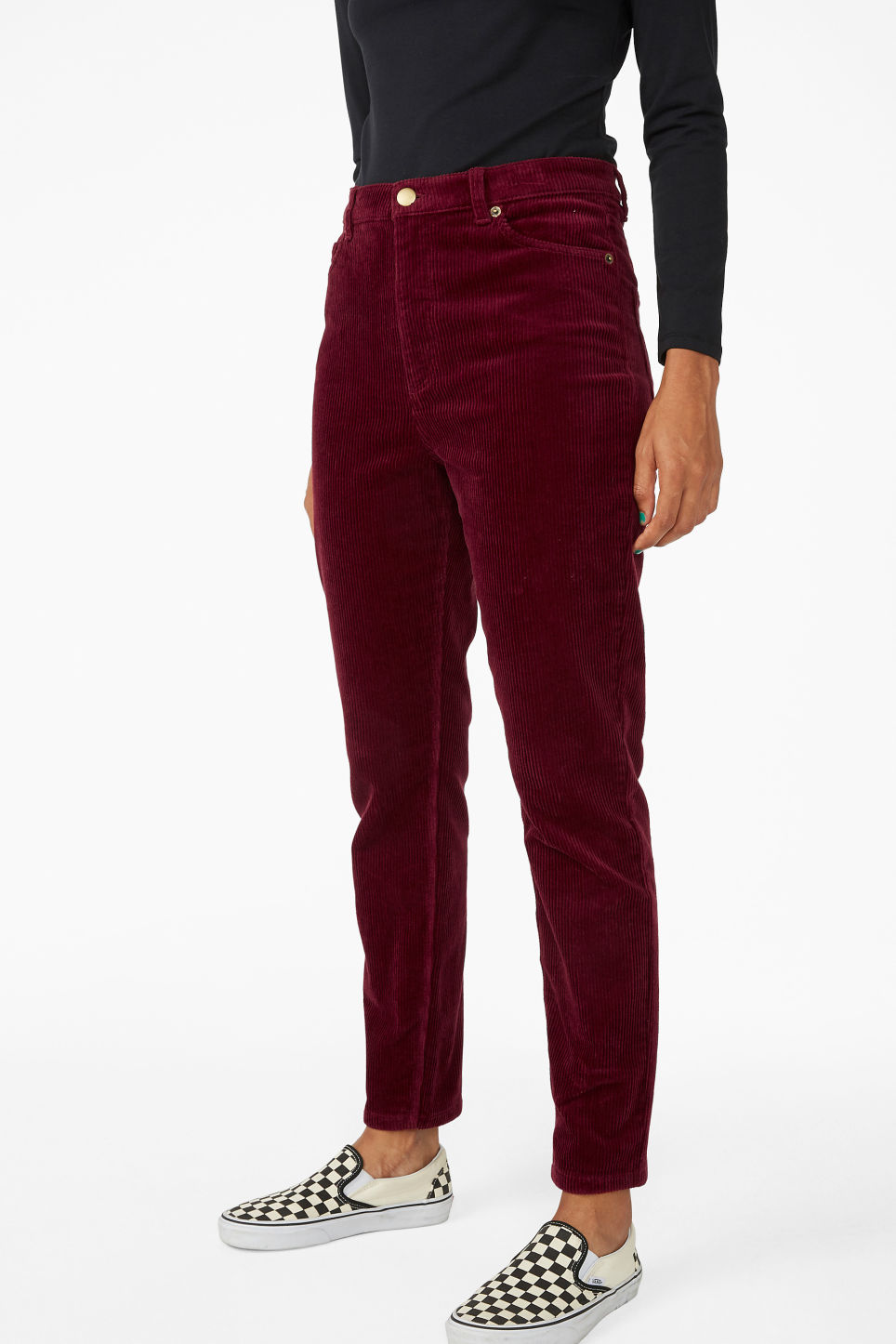 Model side image of Monki slim fit corduroy trousers in red