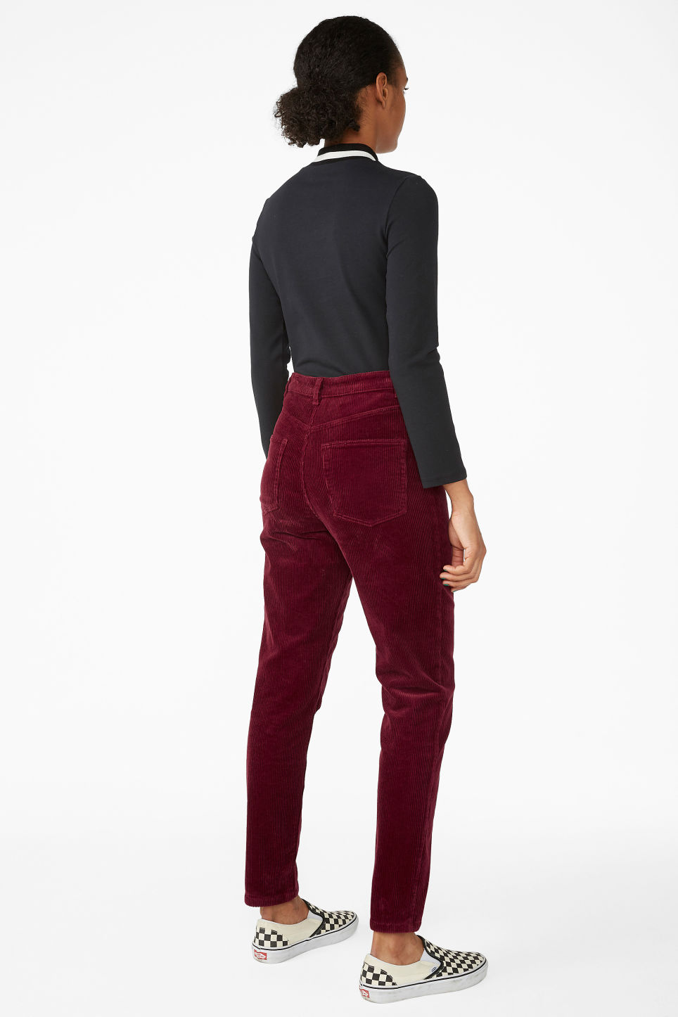 Model back image of Monki slim fit corduroy trousers in red