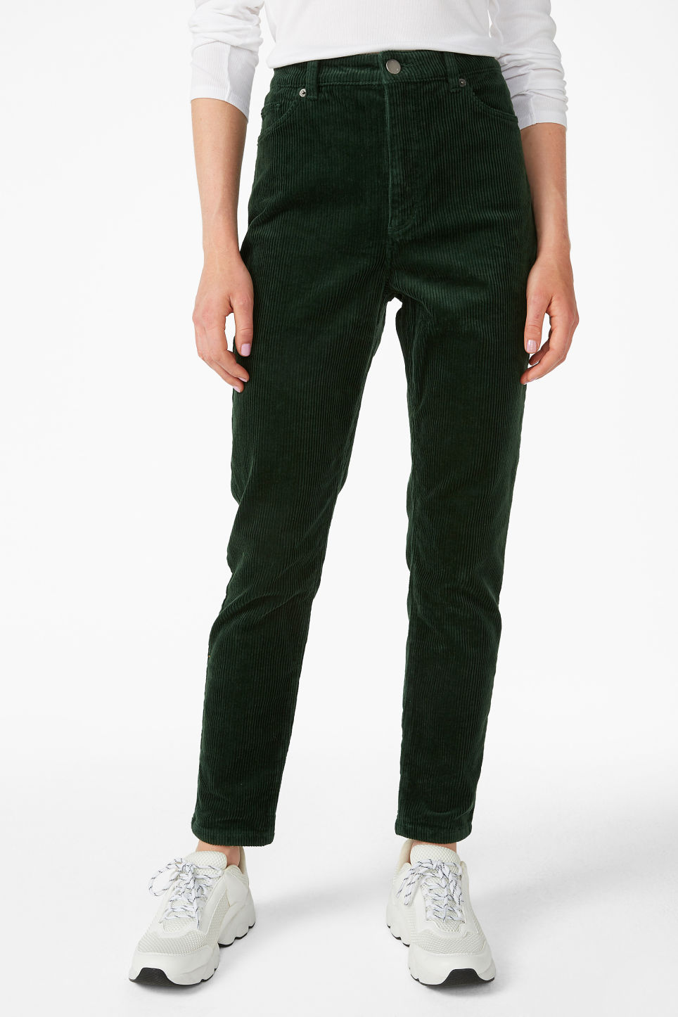 Model side image of Monki slim fit corduroy trousers in green