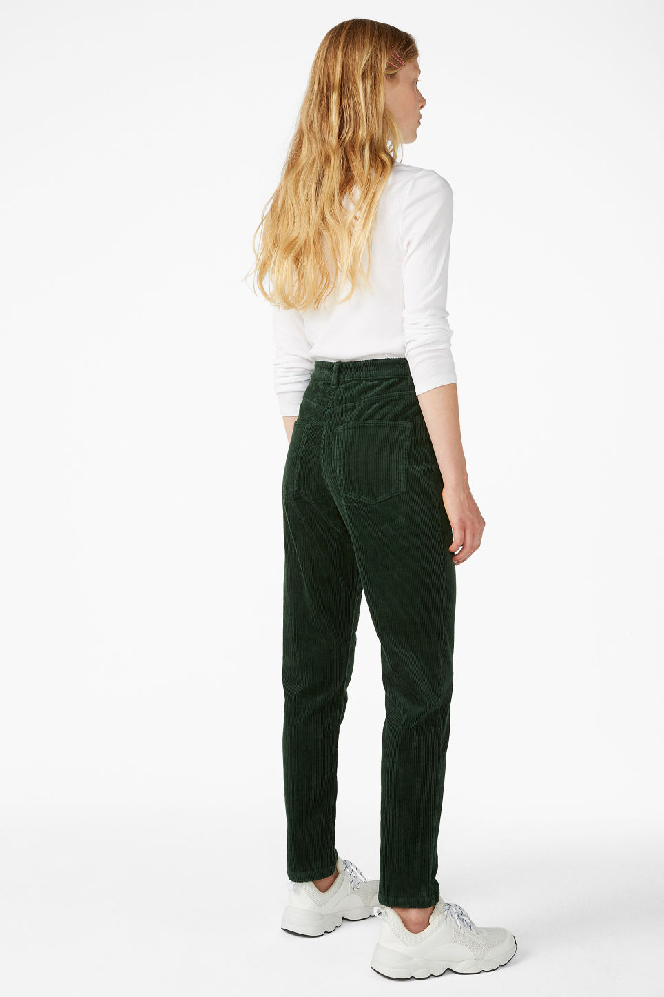 Model back image of Monki slim fit corduroy trousers in green
