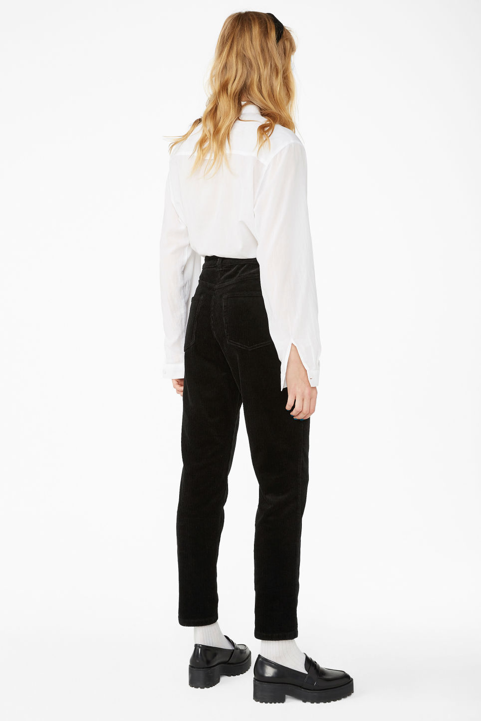 Model back image of Monki slim fit corduroy trousers in black