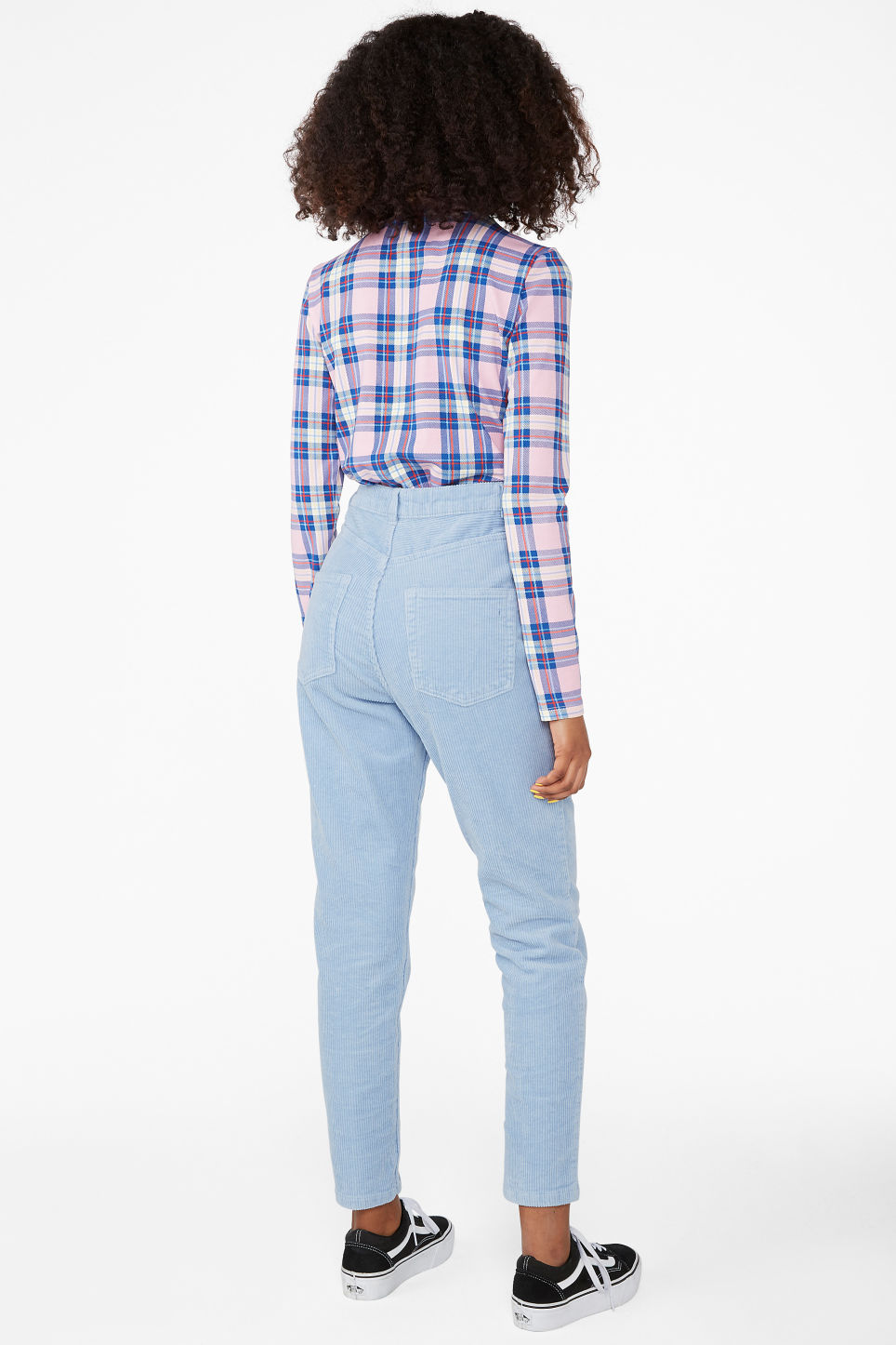 Model back image of Monki slim fit corduroy trousers in blue