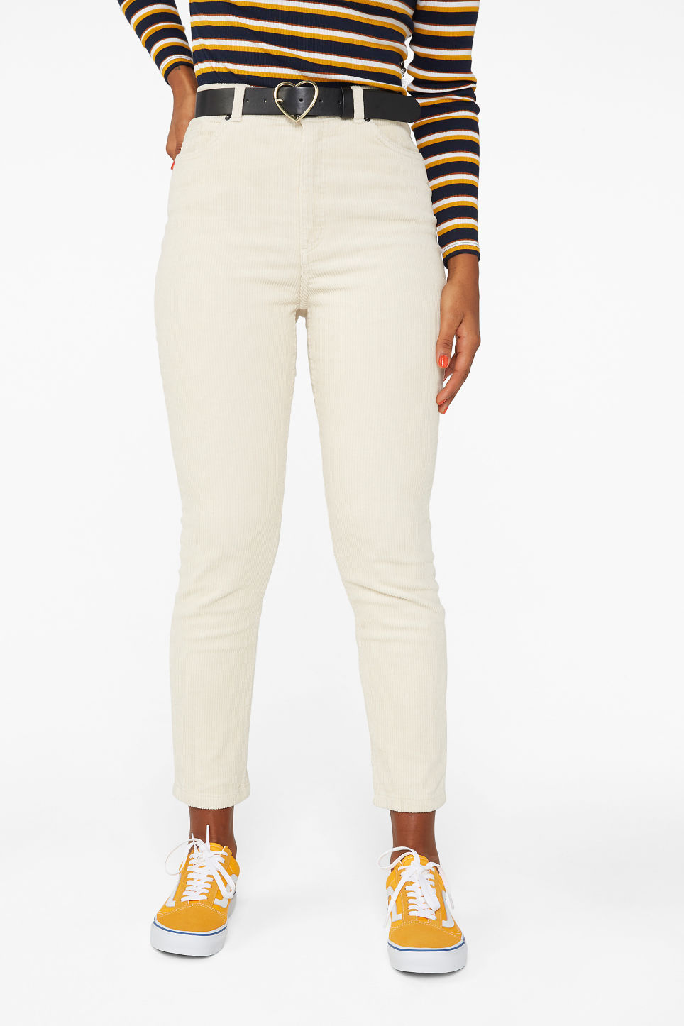 Model side image of Monki slim fit corduroy trousers in beige