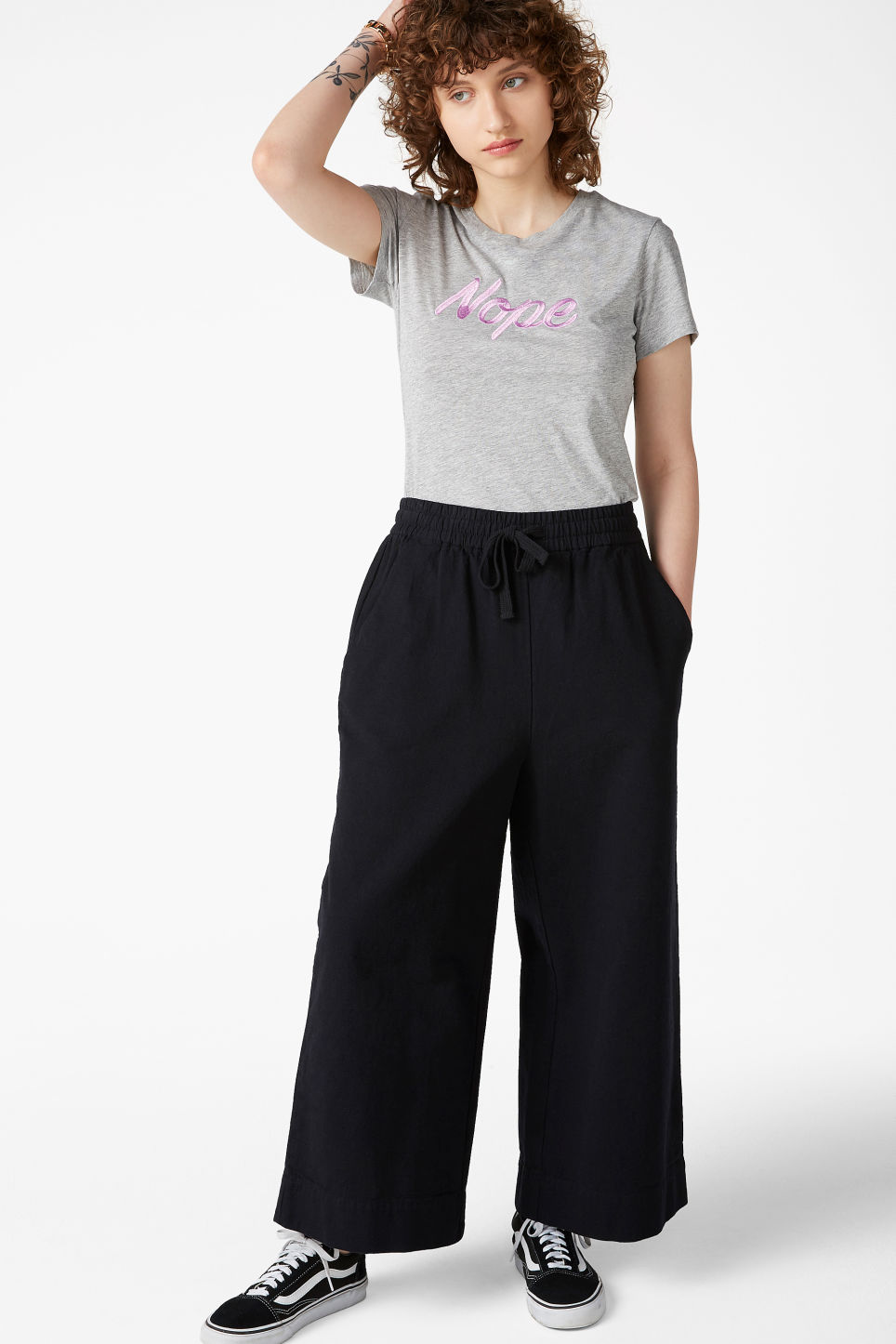 Model side image of Monki cotton tee in grey