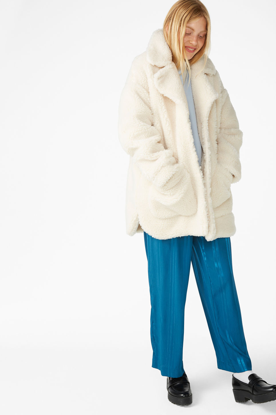 Model front image of Monki fluffy coat in white
