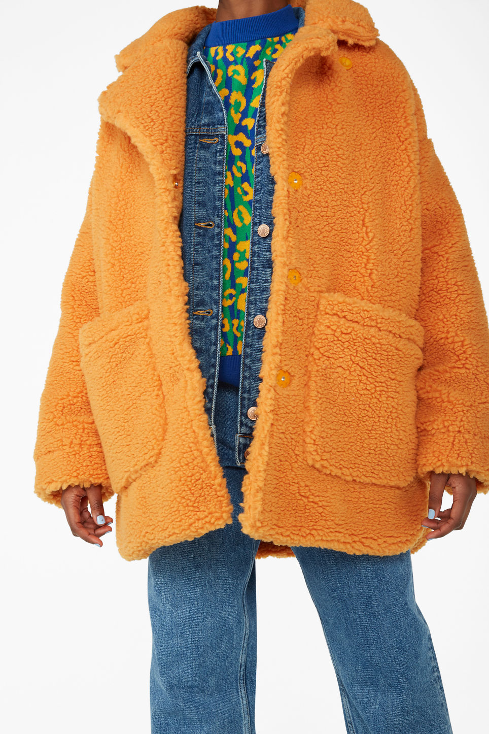 Model side image of Monki oversized faux shearling coat in orange