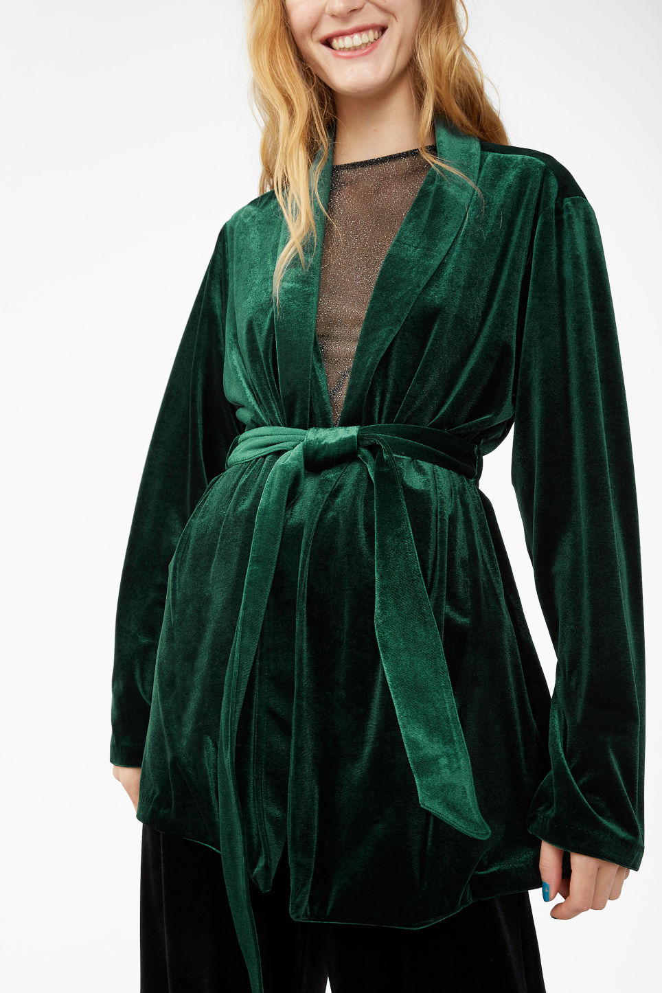 Model side image of Monki velvet wrap blazer in green