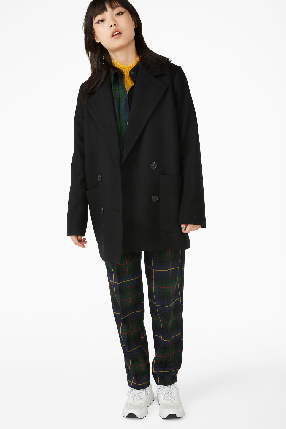 Model front image of Monki double breasted coat in black