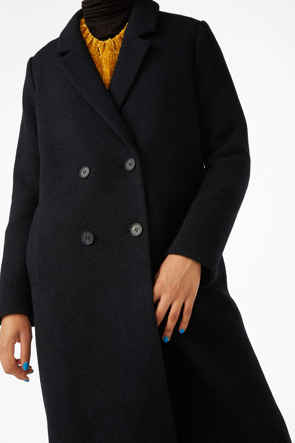 Model side image of Monki classic coat in black