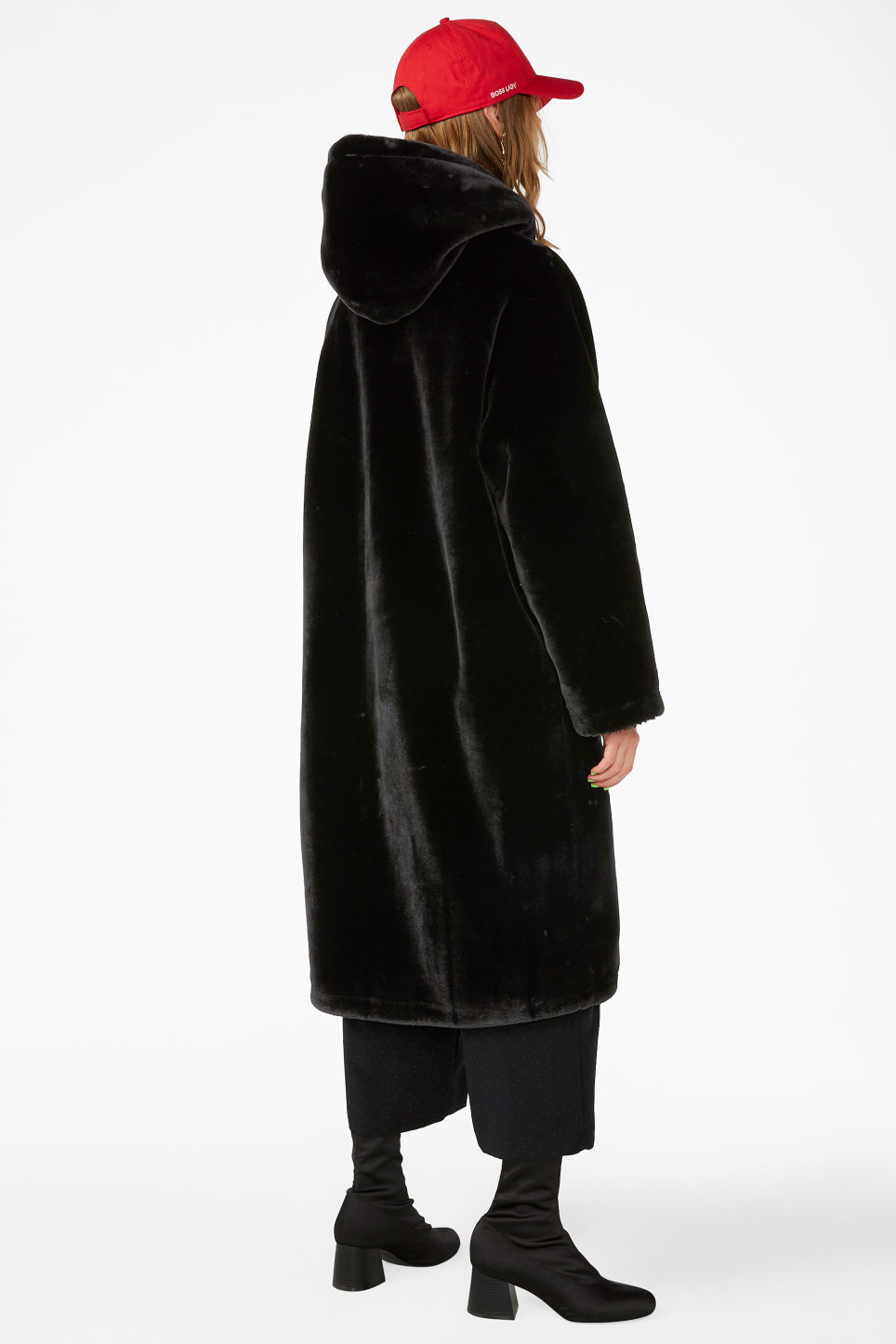 Model back image of Monki long faux fur coat in black