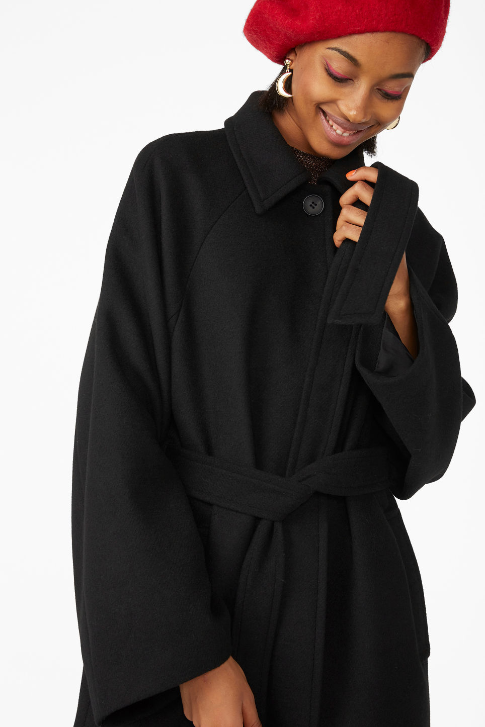 Model front image of Monki belted long coat in black