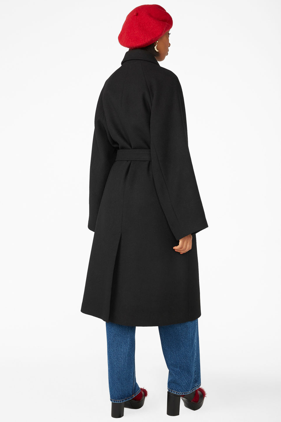 Model back image of Monki belted long coat in black